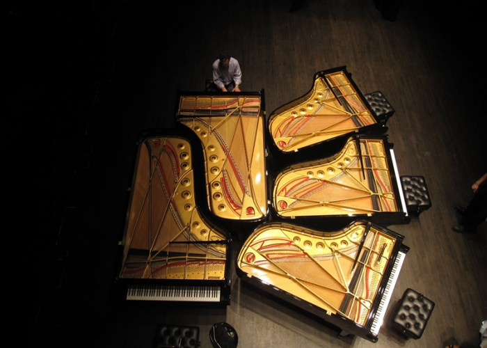 Jerry tuning five Steinway Concert Pianos