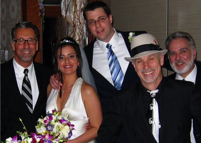 Jerry with bride, groom and band